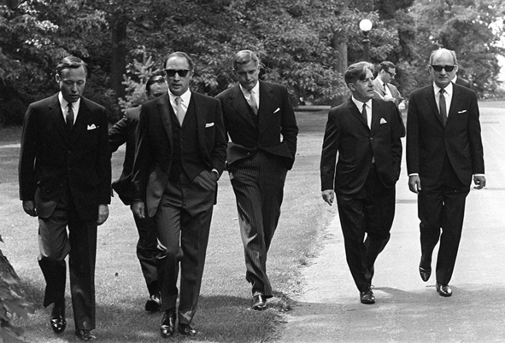 Prime Minister Pierre Trudeau (second from left) wearing dark glasses, arrives with members of his new cabinet for swearing in ceremonies at Government House in Ottawa, July 6, 1968. Saturday. Left to right are: James Richardson, minister without portfolio, D.C. Jamieson, (partly hidden), minister without portfolio, Trudeau, Justice Minister John Turner, Jean Marchand, Forestry Minister, and Gerard Pelletier, State Secretary. Ten years after his death, and more than four decades after it was taken, the photo of Pierre Trudeau striding up the drive at Rideau Hall - flanked by his dark-suited cabinet-to-be - still packs a blast of movie-star, hipster cool. (Doug Ball/CP)